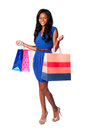 Smiling consumer shopping woman beautiful happy walking fashion with bags wearing pumps blue dress and belt on white Stock Photo