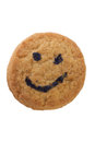 Smiling cookie closeup of coockie with white background Stock Photos