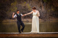 Smiling cople dancing over pond happy same sex couple on dock lake Stock Photography