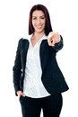 Smiling corporate lady pointing at you Royalty Free Stock Photos