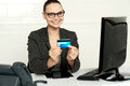 Smiling corporate lady showing credit card Royalty Free Stock Image