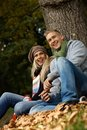 Smiling couple in autumn park Stock Photography