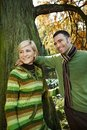 Smiling couple autumn walk park standing together lake Royalty Free Stock Images