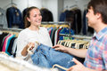 Smiling couple buying blue jeans Royalty Free Stock Photo