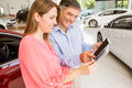 Smiling couple choosing the color of their new car Royalty Free Stock Photo