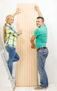 Smiling couple choosing wallpaper for new home repair interior design building renovation and concept Royalty Free Stock Image