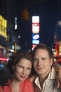 Smiling couple on city street at night closeup portrait of a young Royalty Free Stock Images