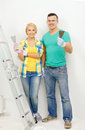 Smiling couple doing renovations at home repair renovation and concept Stock Photos