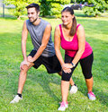 Smiling couple doing streching in the park Royalty Free Stock Photo