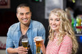 Smiling couple drinking beer