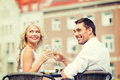 Smiling couple drinking wine in cafe Royalty Free Stock Photo