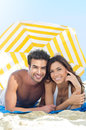 Smiling Couple Enjoying At Beach Royalty Free Stock Photography