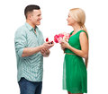 Smiling couple with flower bouquet and ring happiness holidays celebration concept in a box Stock Images