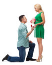 Smiling couple with flower bouquet and ring happiness proposal engagement celebration concept in a box Royalty Free Stock Photography