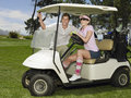 Smiling couple in golf cart young Royalty Free Stock Image