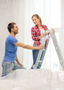Smiling couple hanging curtains Royalty Free Stock Photo