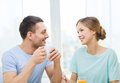 Smiling couple having breakfast at home food and happiness concept Royalty Free Stock Images