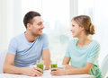 Smiling couple having breakfast at home food and happiness concept Stock Images