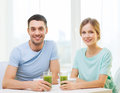 Smiling couple having breakfast at home food and happiness concept Royalty Free Stock Photography