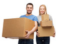 Smiling couple holding cardboard boxes moving home and family concept Stock Photo