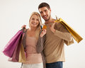 Smiling couple holding shopping bags studio shot of a caucasian Royalty Free Stock Photos