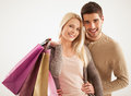 Smiling couple holding shopping bags studio shot of a caucasian Royalty Free Stock Photo