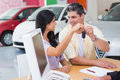 Smiling couple holding their new car key Royalty Free Stock Photo
