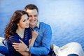 Smiling couple hugging against a background of water blue Stock Photos