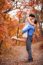 Smiling couple hugging in autumn park. Happy bride and groom in forest, outdoors Royalty Free Stock Photo
