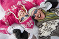 Smiling couple laying together in snow Stock Image