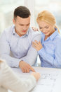 Smiling couple looking at blueprint home designe and architecture concept of their new house office Royalty Free Stock Photography
