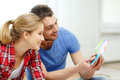 Smiling couple looking at color samples at home repair interior design building renovation and concept Royalty Free Stock Image