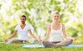 Smiling couple making yoga exercises outdoors Royalty Free Stock Photo