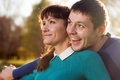 Smiling couple in park at sunshine weather beautiful portrait of the Stock Photography