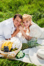 Smiling couple at a picnic happy young making in the park Royalty Free Stock Photography