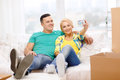 Smiling couple relaxing on sofa in new home moving and concept taking picture with digital camera Stock Photo