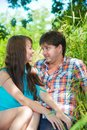 Smiling couple resting on nature happy and hug Royalty Free Stock Images