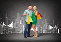 Smiling couple with shopping bags happiness and concept Royalty Free Stock Photos