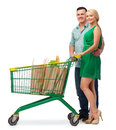 Smiling couple with shopping cart and food in it happiness concept Royalty Free Stock Images