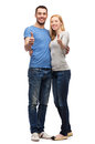 Smiling couple showing thumbs up gesture and family concept Stock Photo