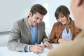 Smiling couple signing contract Royalty Free Stock Photo