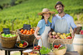 Smiling couple standing by fresh fruits and vegetables Royalty Free Stock Photo