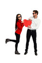 Smiling couple with sunglasses holding paper heart Royalty Free Stock Photo