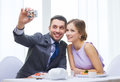 Smiling couple taking self portrait picture restaurant technology and holiday concept with digital camera at resaturant Stock Photography