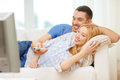 Smiling couple watching movie at home love family and happiness concept Royalty Free Stock Image