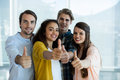 Smiling creative business team showing thumbs up in office Royalty Free Stock Photo