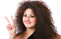 Smiling curly hair woman in a victory gesture Stock Images