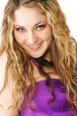 Smiling curly in violet dress Stock Photography