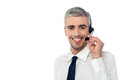 Smiling customer support executive service representative wearing a headset Stock Photography