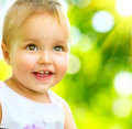 Smiling cute baby girl little portrait outdoor child Royalty Free Stock Image